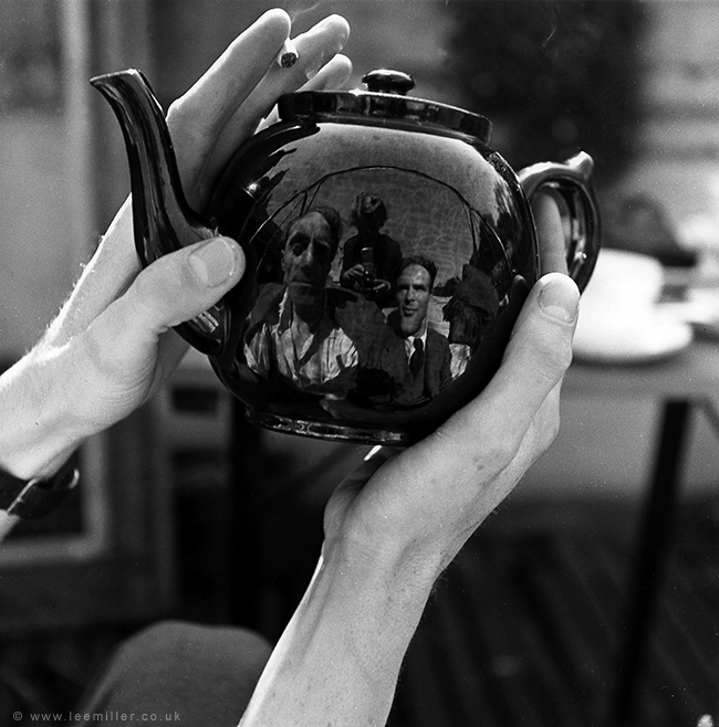 'Portrait of Leslie Hurry in a teapot, including Lee Miller and unknown man, Vale Lodge, Vale of Health, Hampstead, London, England, 1943
